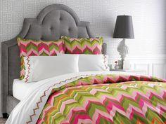 Upholstered headboard + Bold bedding from Jonathan Adler = fab!