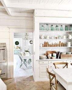 The gingerbread village @carr_bethany made might stay up through January  The kitchen is painted @farrowandball All White. . {on another note everything in our online shop will be 25% off until January 2nd }