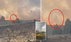 Woman takes photo of a ghost lurking in flames near blaze at her ranch