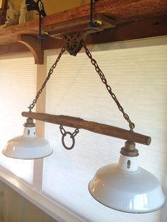 Antique Yoke Pulley light...this should work for the kitchen...I think.