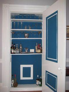 Umbrella closet turned bar!  Love this color!