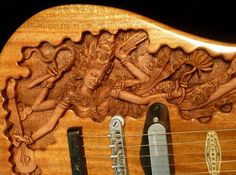 Thai wood craft custom guitar work commissioned by Blueberry Guitars