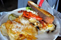 Dad had The Fried Egg Sandwich at Max's Wine Dive --- three fried eggs drizzled with truffle oil and sea salt with applewood-smoked bacon, gruyere, hydroponic bibb lettuce, tomatoes and black truffle aioli between two slices of ciabatta publiese served with Max's chips.