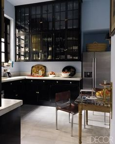 black cabinetry up to the ceiling. i'd take that.