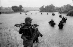 Paratroopers of the U. Battalion, Airborne Brigade hold their weapons above water as they cross a river in the rain during a search for Viet Cong positions in the jungle area of Ben Cat, South Vietnam, during Vietnam War, on Sept. Vietnam War Photos, North Vietnam, Vietnam Veterans, Saigon Vietnam, Vietnam History, Reporter Photographe, Steve Mccurry, Ak 47, Robert Capa