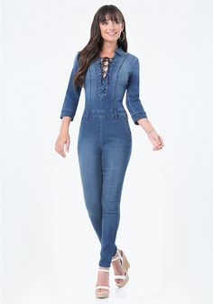 Sexy daytime jumpsuit in clingy stretch denim, finished with a front lace-up closure. Front slash pockets and back welt accents. 3/4 button-cuff sleeves. Back hook-and-eye and exposed zip closure.