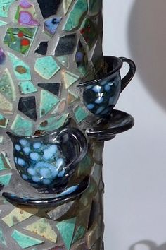 Mosaic teacup accents, so cute!... hum, good way to get rid of my china tea cups