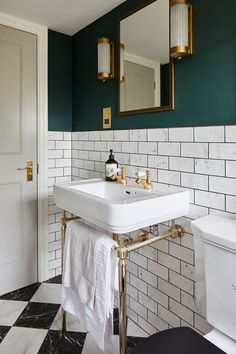 We love the super luxurious feel of this bathroom with its marble effect metro tiles and moody green paint. Upstairs Bathrooms, Downstairs Bathroom, Small Bathrooms, Small Bathroom With Bath, Luxurious Bathrooms, Small Bathtub, Small Kitchens, Master Bathroom, Bad Inspiration