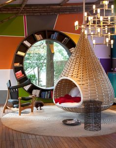 Funky.  Awesome.  Totally Cool.  This is such a fun window and book shelf combo that it would be great for a teen hang out, rec room, or a fun loving younger couple.  And I have to give props to the way cool hanging wicker pod retreat!