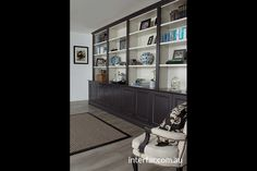 Wall Units | Interfar - Residential - side view, traditional black and white wall unit/bookcase with traditional detailing