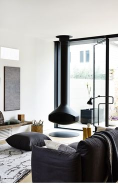 suspended fireplace as a focal point in a living room