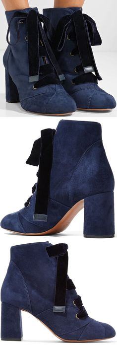 Chloé's 'Graphic Leaves' boots are made from supple navy suede and laced with midnight-blue velvet for a subtle contrast. This pair has tonal appliqués at the round toe and is set on a durable block heel.