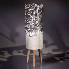 Beirut-based artist Iyad Naja integrates steel nickel copper and brass calligraphy flawlessly into naked concrete to produce furniture designs and projects that are both modern feats and an ode to Arab heritage.