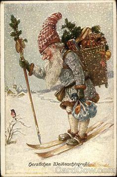 Herzlichen WeihnachtsgruB! Santa in blue on skis
