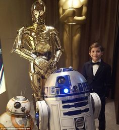 'My new squad!' Jacob Trembley was beyond thrilled when he got the chance to meet the Star Wars droids at the Academy Awards on February 28