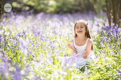 Laughing girl in bluebells www.ninamacephotography.com