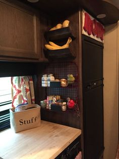 2 Old grain bins for storing potatoes, onions and bananas! A wire double rack adds cute extra storage. We built a cutting board cover for the stove top that adds valuable counter top area in a tiny kitchen.