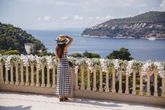 Wearing Asos gingham maxi dress and Boohoo boater hat in the garden of the Villa Ephrussi de Rothschild in St-Jean-Cap-Ferrat, France, decorated with white flowers for a wedding | Bold Bliss