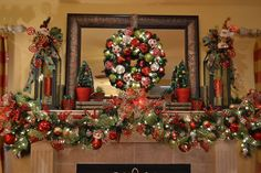 Christmas Mantle 2013 - I decorated the garland with ornaments and ribbon and also made the wreath hanging on the mirror. I made the lantern toppers and added M…