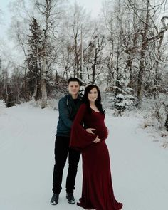 Winter couple maternity photos in the snow. This burgundy bell sleeve maternity gown is the perfect photoshoot outfit for the winter. #SexyMamaMaternity #SexyMama #winterphotography