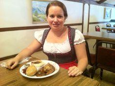 German food: pork shanks, mashed potatoes, red cabbage