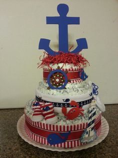 Nautical diaper cake that I made for my daughter's baby shower.  I was thrilled to find diapers with little anchors on them!