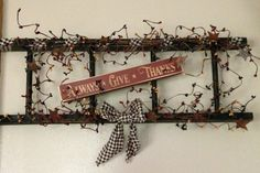 Primitive wooden ladder decorated with a wooden sign and berries - what a perfect match!  Each ladder is 24 long and 8 tall. Decorated with Colonial Mix berries (burgundy, gold, and navy), and a checked ribbon to tie it all together.  Your choice of sign wording. (If no choice is made at check-out, Always Give Thanks will be sent.) Sign colors are ivory or burgundy, as shown. Sign color cannot be changed.  Each item created by Farm Wives Collections is handcrafted, making no two alike. We…