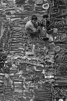 Taken from Ellis Bridge looking over a tool trader's spot at the Ravivar Bazaar (Sunday Market) in Ahmedabad.