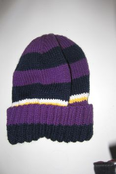 Knitted hat for Jamie in 'Melbourne Storm' colours.
