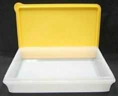 "Tupperware Cold Cut Keeper. Yellow Seal by Tupperware. $13.20. Virtually airtight seal. Sheer Ice container with large-tab seal in Yellow. Dishwasher safe. Stackable. 2½ x 9 x 12"". This versatile container has many uses. It's perfect for storing rolled sandwiches and wraps in the fridge, or keeping cookies and other baked treats fresh in the pantry. It's also ready to go with you to parties or buffets."