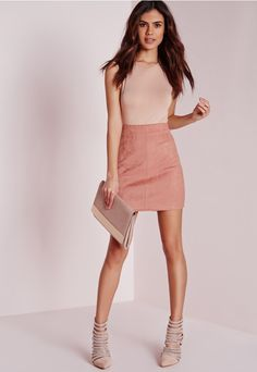 We're head over heels with this beaut suede Skirt. This off the hook rose colour is seriously on point this season and will keep your style game very strong. Team up with a bodysuit and some heeled boots for a flawless style fix.
