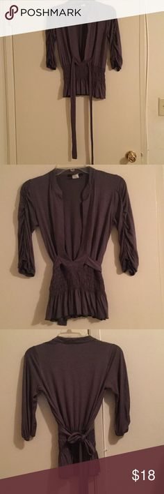 Charcoal Grey Grey Open V neck with tie. Size PM MCM Charcoal Grey top with wide V neck & stretchy elastic scrunched stitching at waist with tie to back. Size Petite Medium. 95% Polyester 5% Spandex. Makes a great outfit with Grey Silk Skirt also posted in my closet. Snug fit at waist but stretchy. MCM Tops Blouses