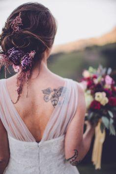 Flower adorned bridal hairstyle | Photo by Chris Spira Photography via http://junebugweddings.com/wedding-blog/romantic-austrian-wedding-wilder-kaiser/