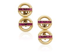 RUBY AND GOLD CUFFLINKSEach designed as an openwork gold circle divided by a line of calibré-cut rubiesMetal: 18k yellow gold Ruby: 20 calibré-cutsSize/Dimensions: Cufflink head 1.0 cm Marks: 750 British assay marks Gross Weight: 9.6 gramsCirca mid-20th century