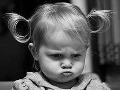 Pouting...this is how I looked when I was little...just not the frown!