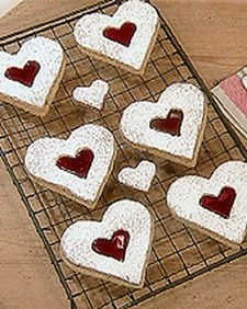 One of the handsome hubbies favorites - this is a Martha Stewart dot com recipe- Named after the jam-filled linzertorte that inspired them, these beautiful heart-shaped cookies are ideal for a wedding dessert buffet, Valentine's Day, or any romantic occasion.        Apricot, strawberry, or cherry jam can be substituted for the seedless raspberry jam in this recipe.