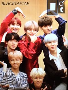 LOOK AT THEM!! ALL OF THEM!! LOOK AT HOSEOKS RADIANT SMILE!!! AND TAE IS THE 'V', HOW FUNNY!!