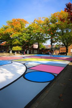 Artist Katrien Vanderlinden has painted colourful shapes inspired by toy bricks onto a basketball court in the Belgian city of Aalst.