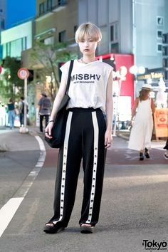 19-year-old Pyon on Cat Street in Harajuku tonight wearing a MISBHV sleeveless top with MYOB NYC pants and Tokyo Bopper platform sandals.