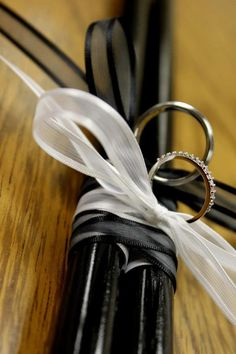 Ring Bearer Pillow Ideas.  My husband and all of his groomsmen are drummers so we thought to incorporate that into the wedding, we'd have the rings tied to some drumsticks :)