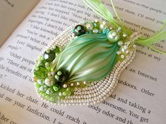 Bead embroidered green pendant with Shibori silk and beads. Italian handmade jewelry by Poppies Dreams