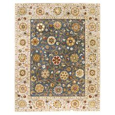 """Wool rug with a floral motif and contrast border. Made in India.  Product: RugConstruction Material: 100% WoolColor: MultiFeatures: Made in IndiaDimensions: 7'6"""" x 9'6""""Note: Please be aware that actual colors may vary from those shown on your screen. Accent rugs may also not show the entire pattern that the corresponding area rugs have."""