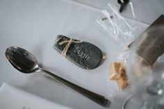 Engraved Pebble Name Place - McGivern Photography | Launcells Barton Country House in Bude Cornwall | Elegant Rustic Barn Wedding | Charlie Brear Torum Gown | Ted Baker Suit | Pink Bridesmaid Dresses