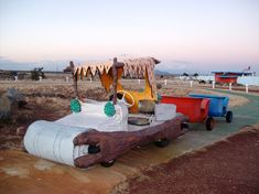 These golf cart cars were once operational for driving around the park. This Town In Arizona Is Modelled After Bedrock From The Flintstones,