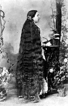 circa 1890:  A lady with hair to her feet.  (Photo by Hulton Archive/Getty Images)