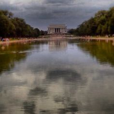 Reflection pond in Washington, D.C. I snapped see the face in the water made by the clouds?