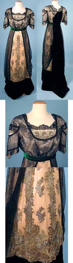Black velvet evening gown, ca. 1912. Black net overdress with jet beads, cream-colored net with gold and silver metallic appliques and beads, jet bead fringe and green velvet ribbon. Black velvet train.