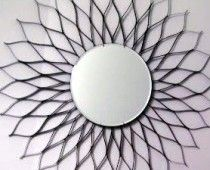I am officially obsessed with sunburst mirrors!