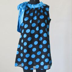 Blue Black polka dot brasso fabric top with a satin tie. Inside is a cotton voil lining.