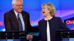 Bernie Sanders receives a standing ovation at the Democratic presidential debate after saying the American people no longer want to hear about Hillary Clinton's emails.